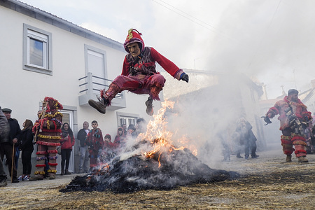 A reveller dressed as a devil is seen jumping a bonfire during the Carnival of Vila Boa de Ousilhão. Vila Boa de Ousilhão is a small village lost in the Trás-os-Montes mountains that keeps the old tradition of celebrating  the carnival (Entrudo). Revellers wear devil masks made of wood and roam the village in search of fun.