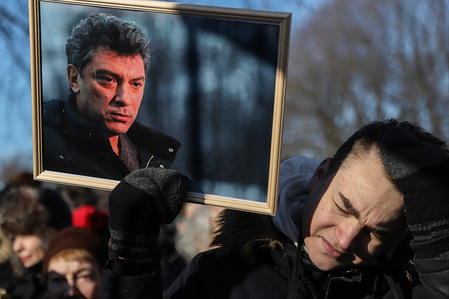 A man holds a photo of Boris Nemtsov during the anniversary rally. Hundreds of people take part in a memorial gathering to mark the fifth anniversary of Boris Nemtsov's assassination. Nemtsov was a prominent Putin critic who was assassinated on 27 February 2015 in Moscow.