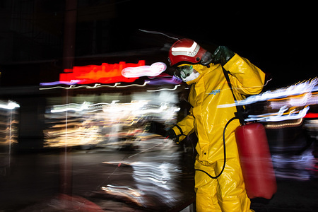 A firefighter disinfects the street.After the spread of the Coronavirus in Iran, people have been restricted to the streets so people leave their homes only for essential purchases and health items. The military and fire forces decided to disinfect every passage and city every night.