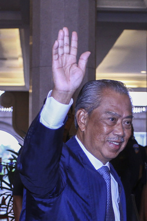 Prime Minister Tan Sri Muhyiddin Yassin waves at Putra Perdana on his first day as the Prime Minister. Tan Sri Muhyiddin Yassin was appointed as the 8th Malaysian Prime Minister after Tun Mahathir resigned from the position. The new Prime Minister had visited the Prime Minister's Office at Perdana Putra, Putrajaya for a clock-in session on his first day.