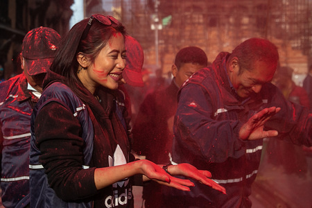 People throw vermilion powder during the festival. The Holi festival also known as the Festival of Colours, marks the beginning of spring, and it's celebrated with great enthusiasm all over Nepal.