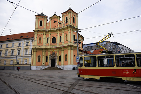 A tram operates next to the Old Cathedral of Saint of Matha and Saint Felix of Valois at the the old town.