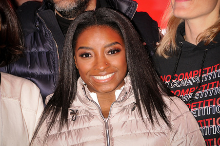NEW YORK, UNITED STATES - MARCH 03, 2020: Olympic gymnast Simone Biles takes over Times Square to promote her skincare brand SK-II in New York City.