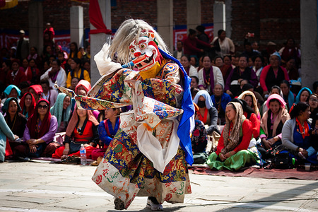 A masked dancer performs a traditional Cham dance during the rituals. Hyolmo Tsechu prayer rituals are celebrated once every year by the Hyolmo community at the Hyolmo Monastery for peace, harmony and prosperity.