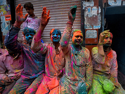 Devotees seen covered in color during the Lathmar Holi celebration at Barsana.  The myth behind this Lathmar Holi is related with Hindu God Lord Krishna who as per local belief came from his hometown Nandgaon to his lovers place at Barsana and teased Radha and her friends. With this common belief since more than 100 years, women of Barsana still maintaining the ritual and beating the outsiders of Nandgaon with sticks (Lathi) to maintain the tradition on this particular day.
