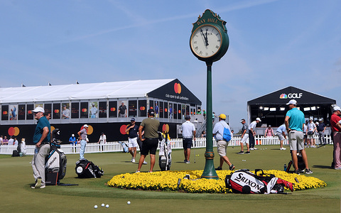 Golfers practice on the putting green during the pro-am round at the Arnold Palmer Invitational presented by Mastercard at the Bay Hill Club & Lodge.