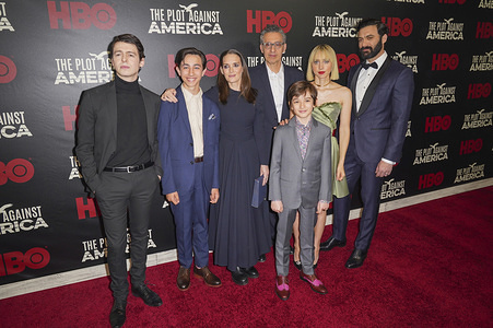 """NEW YORK, UNITED STATES - MARCH 4, 2020: (L to R) Anthony Boyle, Caleb Malis, Winona Ryder, John Turturro, Azhy Robertson, Zoe Kazan and Morgan Spector attend HBO's """"The Plot Against America"""" premiere at Florence Gould Hall."""