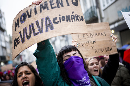 A protester holds a placards during the march. International Women's Day march through the streets of Porto in a protest against inequality, discrimination, violence and also demanded changes that the organization announced today.