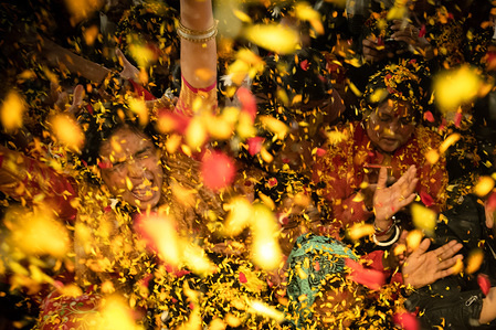 Devotees sing and dance as flower petals are being thrown during the Gaura Purnima festival in Kathmandu. The festival is celebrated to mark the day when Lord Krishna changed his colour to golden and advent as Gauranga.