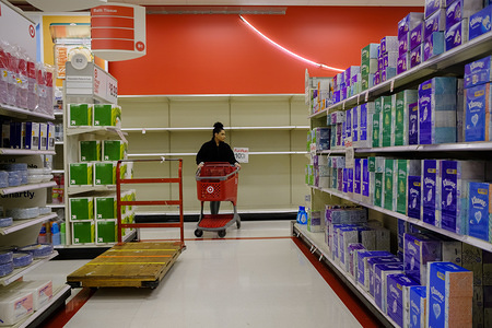 BLOOMINGTON, UNITED STATES - MARCH 10, 2020: An aisle that had toilet paper been completely cleared out by Coronavirus shoppers at a Target store in Bloomington. Shoppers have been panic buying toilet paper, cleaning supplies, wipes, paper towels, cold medicine, pain relievers, immune boosting vitamins, and other items on Coronavirus pandemic fears.
