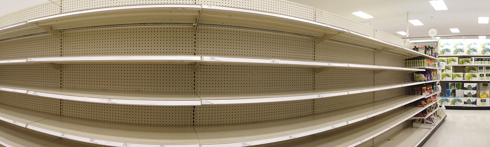 BLOOMINGTON, UNITED STATES - MARCH 10, 2020: (EDITOR NOTE: Image taken with a panoramic mode) An aisle that had wipes for sale been completely cleared out by Coronavirus shoppers at a Target store in Bloomington. Shoppers have been panic buying toilet paper, cleaning supplies, wipes, paper towels, cold medicine, pain relievers, immune boosting vitamins, and other items on Coronavirus pandemic fears.