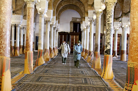 TUNIS, TUNISIA - MARCH 13, 2020: Officials doing the disinfection as a precaution against the coronavirus (COVID-19) at Al-Zaytuna Mosque in Tunis.