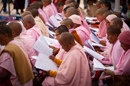 KATHMANDU, NEPAL - MARCH 14, 2020: Buddhist monks attend a mass prayer for the victims of corona virus at Boudhha stupa also known as Boudhanath in Kathmandu. World Health Organisation (WHO) announced 132,758 people worldwide have been diagnosed with the corona virus (COVID-19) disease.