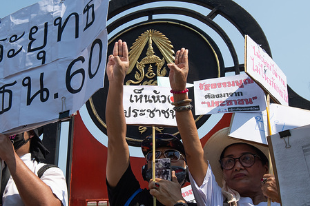 Activists making an anti-dictatorship gesture during a rally demanding Prime Minister Prayut Chan-o-cha's resignation. Protesters took the streets to show their anger against Prime Minister Prayut Chan-o-cha asking him to resign since the 2017 constitutional law was not drafted from the people.