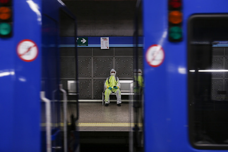 A man wears protective clothing and face mask as a preventive measure against the coronavirus in a metro station. Spain has declared the state of alarm. the most contagious area of the country has adopted strict measures against the Covid19. All business will remain closed except groceries, drug stores and first necessities suppliers. Mobility restrictions may also be applied for most citizens in the coming few days.