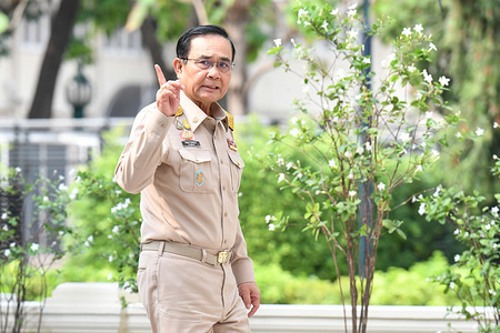 Thai Prime Minister Prayut Chan-o-cha gestures as he arrives for a weekly cabinet meeting at the Government House in Bangkok.