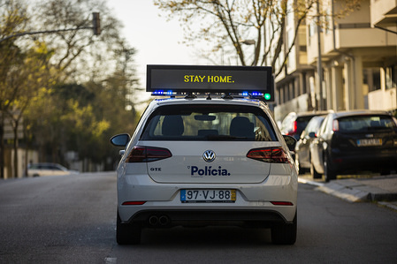 A police car seen with a sign advising people to stop the coronavirus by staying at their homes in the city of Porto. The Minister of Health, Marta Temido, announced this Monday the first death in Portugal due to the coronavirus, 80-year-old man who died in the early afternoon at Hospital de Santa Maria.