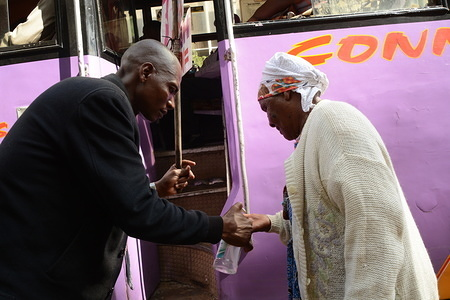 A staff worker of Double M bus disinfects hands of a passenger with sanitizer as a preventive measure against the spread of Coronavirus in Nairobi. Kenya has since recorded three cases of the Covid-19.