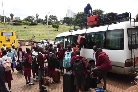 Students of Moi High School Kabarak load a mini bus with suitcases at Uhuru Park in Nairobi as they wait to be ferried to their homes following an order by the Kenyan government to suspend learning in all educational institutions as a preventive measure against the spread of Coronavirus. Kenya has since reported four cases of the COVID-19.