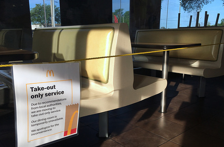 TITUSVILLE, UNITED STATES - MARCH 18, 2020: A dining room at a McDonald's in Titusville, Florida is seen roped off as restaurants across the United States begin to temporarily close dining rooms in favor of take-out and drive thru options in an effort to contain the spread of the coronavirus (COVID-19).