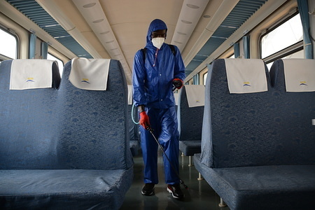 A worker at Nairobi Terminus fumigates a passenger train as a preventive measure against COVID-19. Kenya on March 18, 2020 confirmed three more cases of Coronavirus, bringing the total number of those affected to seven.