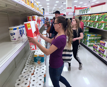 ORLANDO, UNITED STATES - MARCH 19, 2020: Customers rush to purchase toilet paper at a Target store during the panic shopping. People stock up on food and personal hygiene products in response to the coronavirus (COVID-19) pandemic.