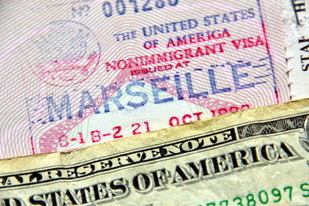 In this photo illustration an american visa stamped on a French passport. US authorities are suspending the issuance of visas in several countries around the world due to the pandemic of Coronavirus.