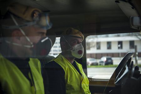 Members of the Spanish Military Emergency Unit, wearing face masks as a preventive measure, during the disinfection tasks at the Pamplona Immigration Office. A total of four trucks and 15 military personnel wearing protective equipment continue the disinfection work entrusted to the Spanish Military Emergency Unit by the Ministry of Interior, in areas that could have been infected with the coronavirus (Covid-19).