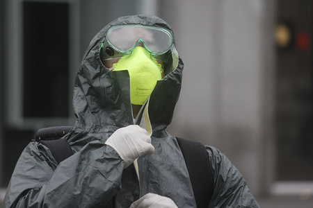 A member of Spanish Emergency Army Unit wears protective clothing during a disinfection session in Puerta del Sol, Madrid. Disinfection missions are carried out every day by the members of UME (Spanish Emergency Army Unit) since the state of alarm was declared in Spain on Saturday, March 14th. The country has been in a lockdown as coronavirus victims increase.