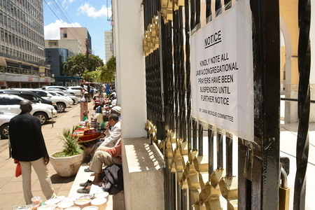 A notice announcing the temporary suspension of prayers is pictured at the entrance of Jamia Mosque in Nairobi amid fears of covid-19. The Kenyan government has banned all public gatherings/activities, rallies and crusades. Places of worship are allowed to hold prayers provided they have hand sanitizers. Kenya has so far reported only seven cases of coronavirus.