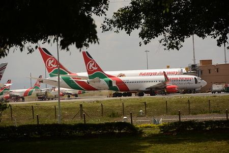 Kenya Airways planes are parked at the Jomo Kenyatta International Airport in Nairobi.  The Kenyan government announced that starting on March 25, 2020 midnight, they will not allow international passenger flights to either land or take off from Kenya as a preventive measure against covid-19. Kenya has so far registered only 25 cases of coronavirus.
