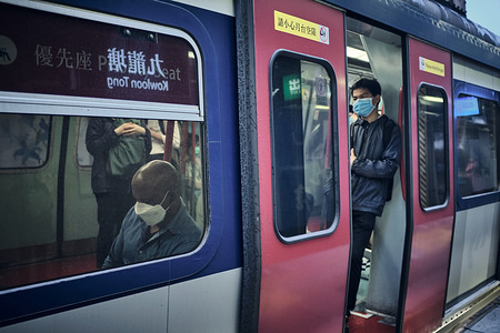 A man travelling on a train wearing a face mask as a preventive measure during the corona virus pandemic. Hong Kong has so far reported a total of 410 confirmed cases of the COVID-19 coronavirus and 4 people have died as a result.