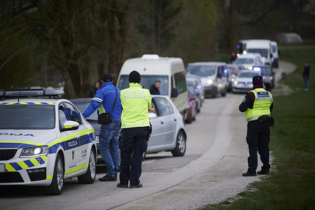 LJUBLJANA, SLOVENIA - MARCH 25, 2020: Convoy of vehicles by Serbian citizens. An organised convoy was prepared for Serbian citizens mostly construction workers returning from various parts of Europe like Germany, Austria and Slovenia but were not allowed to cross the borders due to the coronavirus crisis and have been waiting for several days.