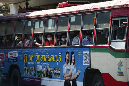 Passengers on a bus wearing surgical masks as a preventive measure, during the coronavirus (Covid-19) pandemic. Thai government imposed a state of emergency decree that started on March 26, 2020 for the tackle to coronavirus (Covid-19) pandemic. On March 27, 2020 Thai public health ministry reported 91 new cases patients of coronavirus (Covid-19), raising the total to 1,136 and 5 deaths.