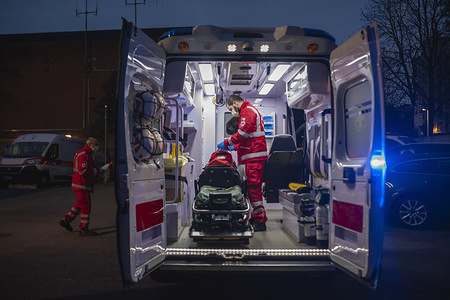 A Volunteer prepares an ambulance for night service. Due to the Covid-19 emergency, the Crisis Unit of the Red Cross Committee provide help to the citizens who need assistance in several municipalities, they offer commissions like food and medical supply, deliveries of prepared meals in hospitals, and ambulance services.