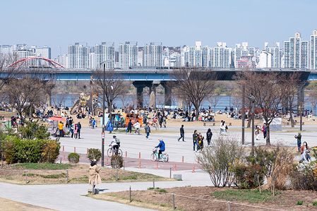 People are seen at Yeouido Hangang Park. Residents in South Korea still gather in large numbers after the government officially recommended people to keep social distance as a preventive measure against the spread of Coronavirus.