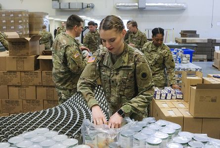 Members of the Ohio National Guard help to pack food and supplies for those in need at the Mid Ohio Foodbank in Columbus. Due to the ongoing Coronavirus Pandemic and rising unemployment, the demand placed on Foodbanks around the United States has grown rapidly. The National Guard has been deployed to assist with the stocking, packaging, and distribution of food throughout the state.