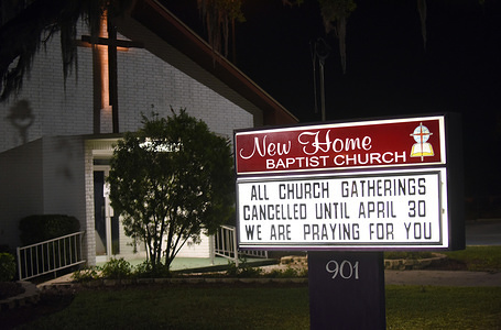 """LAKELAND, UNITED STATES - APRIL 2, 2020: View of a sign saying """"All church gatherings are cancelled until April 30th"""" at the New Home Baptist Church  amid Coronavirus outbreak. Many churches have temporarily replaced regular services with on-line services."""