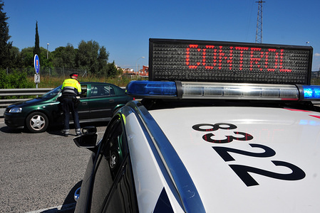 A Catalan Police officer at a control point enforcing the state of alarm during the corona virus crisis. The Catalan Police enforcing the instructions of the state of alarm decreed by the Government of Spain following the Covid-19 health crisis at the entrance to beach towns. People who do not prove a reason for mobility are fined from € 600 to € 30,000.