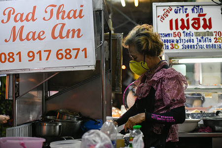 Food vendor wearing a face mask as a preventive measure, during the corona virus pandemic. Following the increase in the number of people infected with the Covid-19 virus in Thailand, the public is responding more to the alert of wearing masks as a protective measure. Thailand's Health Ministry recorded a total of 2067 infections, 20 death and 612 recovered since the beginning of the outbreak.