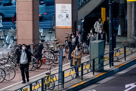 People wearing face masks as a preventive measure, during the corona virus pandemic. The Tokyo metropolitan government has again asked residents to stay at home this weekend following a surge of new infections of Coronavirus (COVID-19).