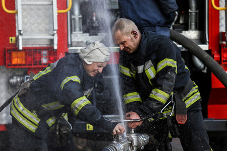 Firefighters prepare to extinguish fire.