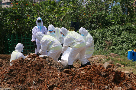 Gravediggers and health workers dressed in protective suits burying the body of a coronavirus victim at the public cemetery in Dhaka. Bangladesh has confirmed 123 cases, with 12 deaths due to coronavirus (COVID-19) according to the IEDCR officials.