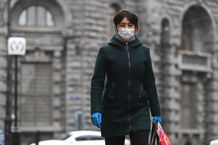 A woman wearing a face mask and gloves as a precaution against the spread of coronavirus walks along the subway. Russian Prime minister Mikhail Mishustin limits sales of certain medical products. Only pharmaceutical companies get right to sell masks, respirators and gloves.