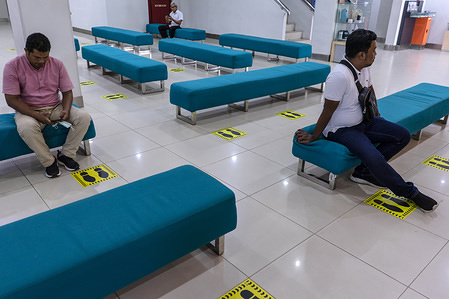 Customers sit according to the social distancing signs applied at a bank as a preventive measure against the spread of Coronavirus in Lhokseumawe. Indonesian government has issued government regulations on large-scale social restrictions and presidential decisions regarding the status of public health emergencies because citizens in Indonesia who are positive with COVID-19 continue to grow. Latest reports confirmed positive of coronavirus in Indonesia become 2,738 cases with 221 deaths.