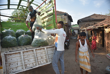 Farmer Weighting and load fresh Ladyfingers from a farm during the nationwide lockdown. Following the restricted movements and closure of main markets during the 21 day lockdown, demand for all vegetables in the city has increased. The few farmers that can get access to the demand are seen busy in this period of lockdown.