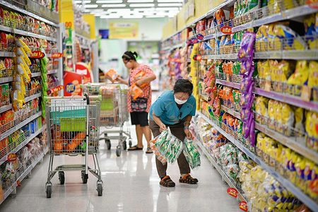 People wear protective masks as a preventive measure at a supermarket during the corona virus pandemic. Thailand has so far reported 2,258 cases of COVID-19 coronavirus with most of the cases reported in the Capital city Bangkok.