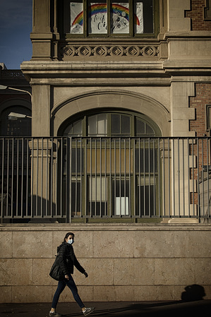 A woman wearing a face mask as a preventive measure against the spread of coronavirus walks near the Hospital Clínic in Barcelona. Barcelona reaches its 25th day of home confinement except for essential activities due to the spread of coronavirus.