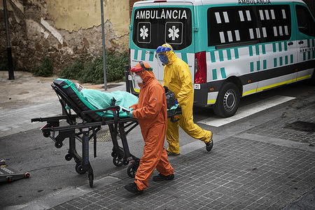 Two ambulance personnel are seen wearing virus safety clothing taking an elderly man to the hospital who has tested positive for the coronavirus test. The COVID19 crisis is festering with the elderly living in nursing homes. According to Social Affairs, since the beginning of the crisis, more than 1,100 elderly have already died.