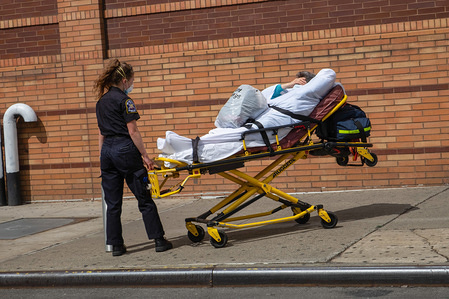 """A coronavirus patient being discharged from a hospital in Brooklyn. According to the information given by the Governor Andrew Cuomo it would appear that New York state has begun to """"flatten the curve"""" with a decrease in hospitalizations and new infections of Coronavirus (Covid-19)."""